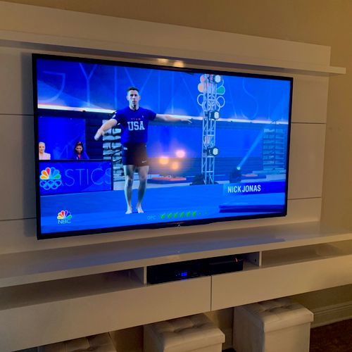 Hanging entertainment center installation and TV mounting.
