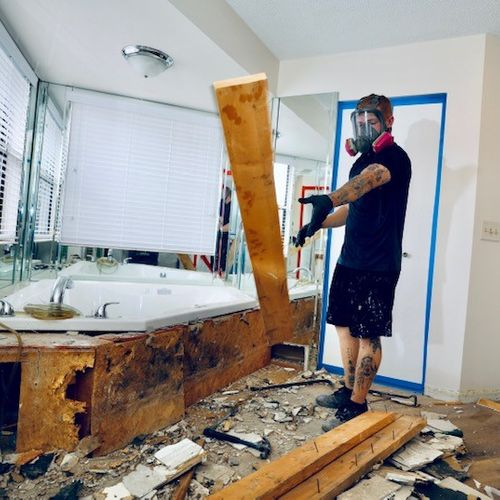 Removal of mold from a jacuzzi tub.