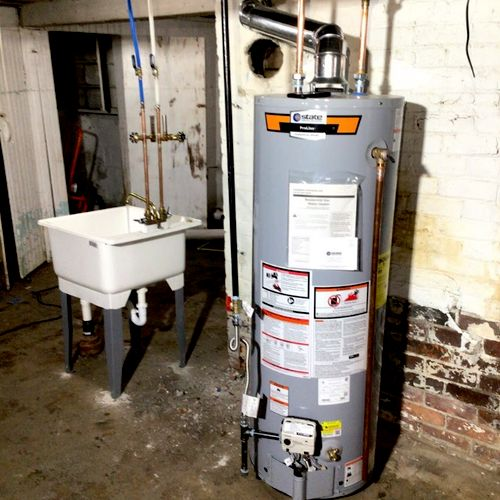 water tank and laundry sink w/faucet