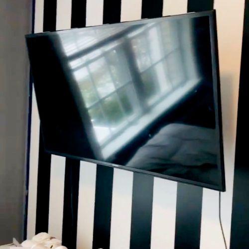 Custom wallpaper, 50 inch tv mounted on a full motion mount