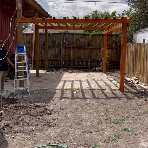 A stone patio and a custom pergola that we installed in downtown salt lake. We left wider gaps up top...