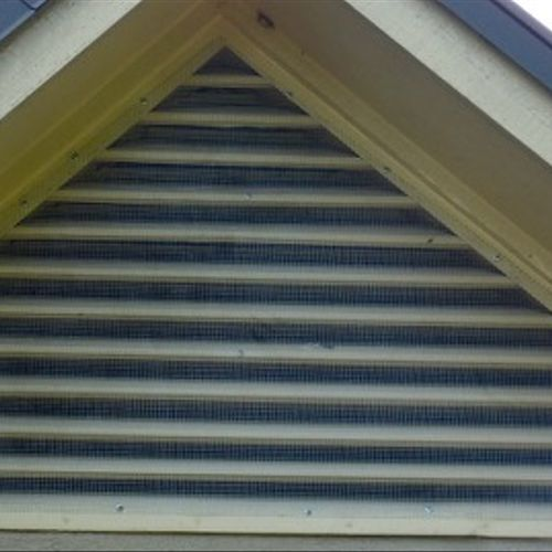 """Gable vent screened with 1/4"""" hardware cloth."""