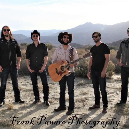 Just Dave Band posing in the desert