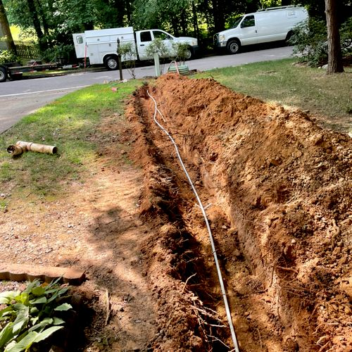 100ft water line replacement from city meter to house with sewer spot repair to remove roots.