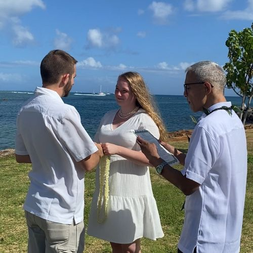 Leis exchange and vows.