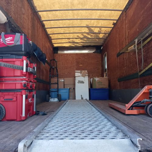 24ft Box Truck - Fully equipped to transport items.