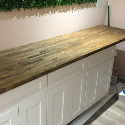 Painted cabinet with stained countertop