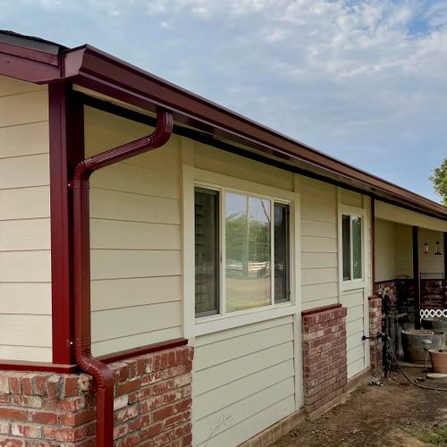 """New 6"""" K-Style Seamless Gutters and downspouts."""