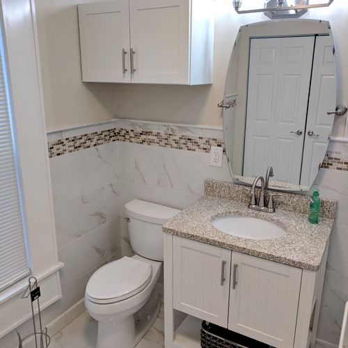 All plumbing and electrical fixtures, plus cabinets and tile.