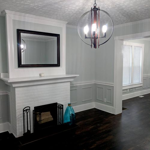Wainscoting, mantelpiece, baseboards and flooring.
