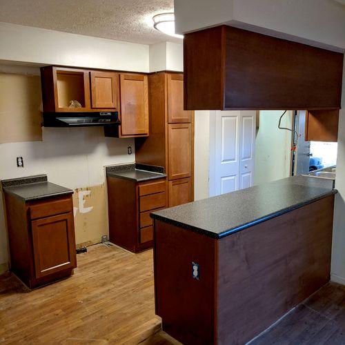 Cabinets, counter tops, rangehood, cabinet backskin plus trim.