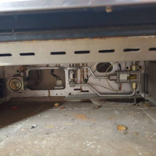 Underneath stove before