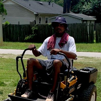 Avatar for Man and A Mower