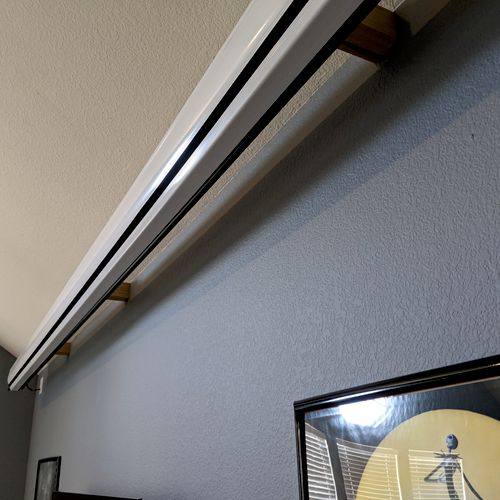 Projector screen mount to drop in front of TV