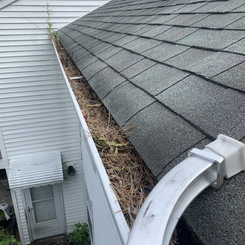 Before shot of gutters we were hired to clean