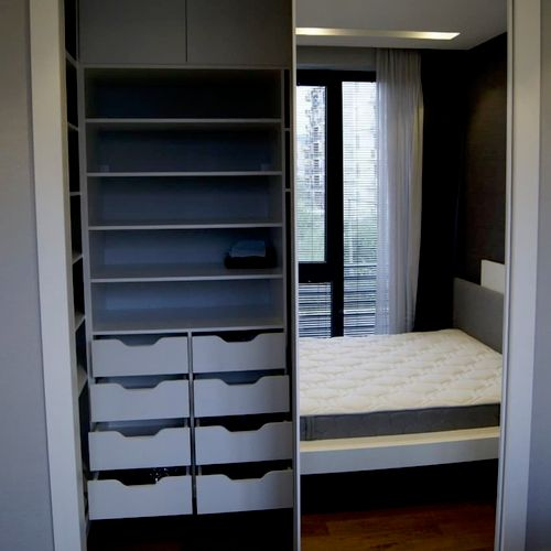 """Walk in Master Closet, 20"""" deep drawers with custom """"handle-less"""" faces."""