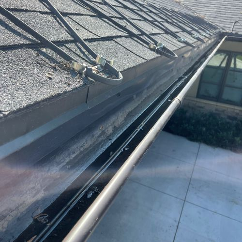 These are after photos of  her gutters! it took us an hour to completely clean the gutters on this two story home!