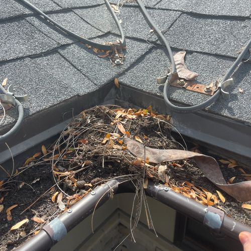 These were the gutters of a 95 year old home owner in Holladay, her gutters hadn't been cleaned in years! Before #1