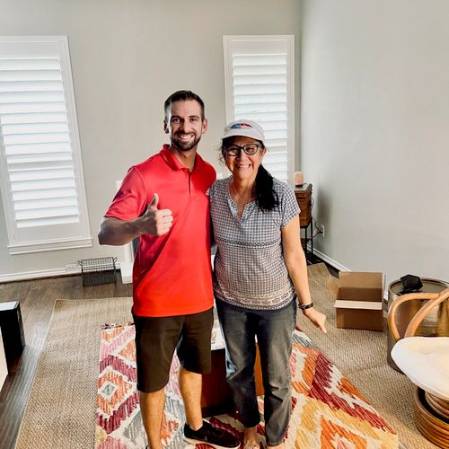 One of our owner's, JC, with a happy client after her move!