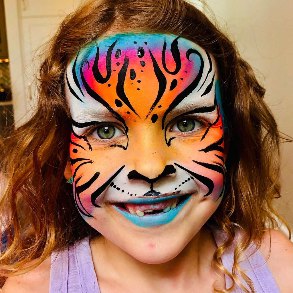 Creative Faces- Face Painting and Henna Tattoo.