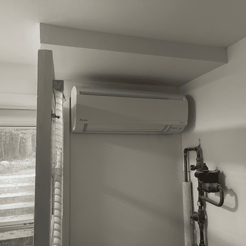 Successful installation of a 7k BtuH wall mounted min-split indoor unit in a customer's utility room