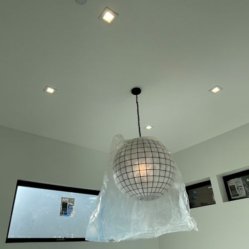 """Install of """"Globe"""" light fixture and 4 can lights"""