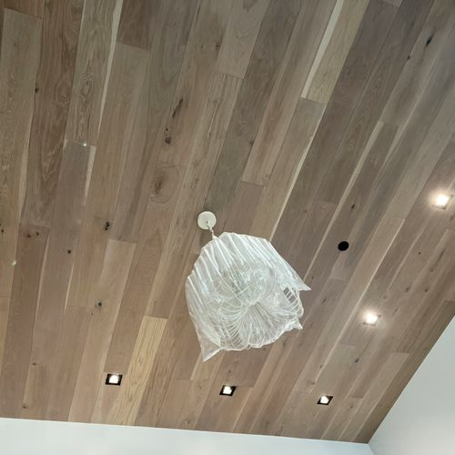 Installation of Chandelier & Lights (had to trim wood to fit can trim)