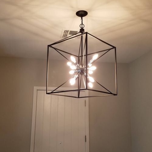 installed this large scale, modern lighting at entry