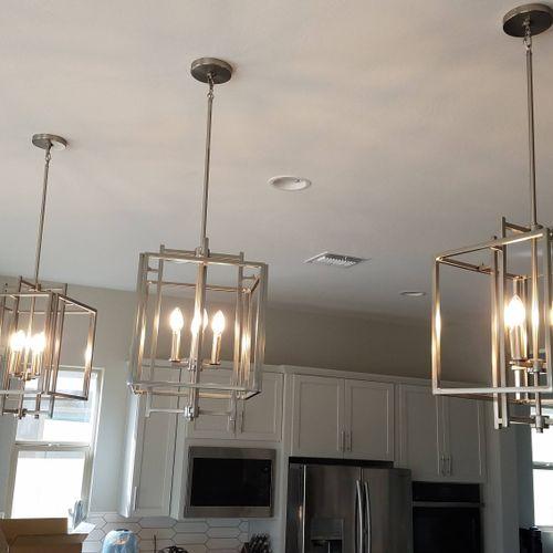 installed 3 modern pendant lights over kitchen island